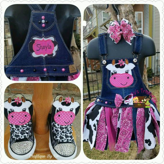 Are you ready for a ho-down? Well grab your partners and this overall fabric tutu dress and square dance the day away!  This listing is for a fabric tutu attached to a denim bib. The fabric of the tutu is cow print, denim, tulle, and pink bandanna. The bib is embellished with a cow face patch. A matching hairbow or headband is also included. An additional patch with a name can be added to the back for an additional $7. Please be sure to select the w/ name option from the drop-down if thi...