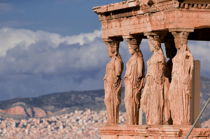 Visit the Erechtheion, a temple located on the Acropolis of Athens.