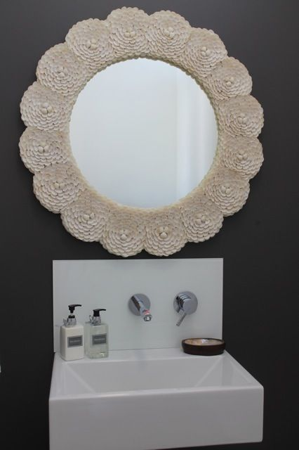Using a big floral inspired frame can add so much character to your bathroom.