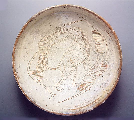 """Bowl with Cheetah, ca. 1100-1300 AD. Byzantine. """"Predatory cats and birds may have been intended to evoke the hunt, a popular pastime for members of the imperial court and ruling classes and regarded as good practice for military action. Treatises and copies of ancient texts on hunting dating to the eleventh and twelfth centuries suggest a renewed interest in the sport."""""""