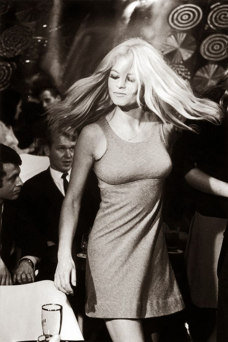 """Brigitte Bardot dancing in a scene from the movie """"Two Weeks In September"""", 1967. Photo (c) Reg Lancaster/Getty Images"""