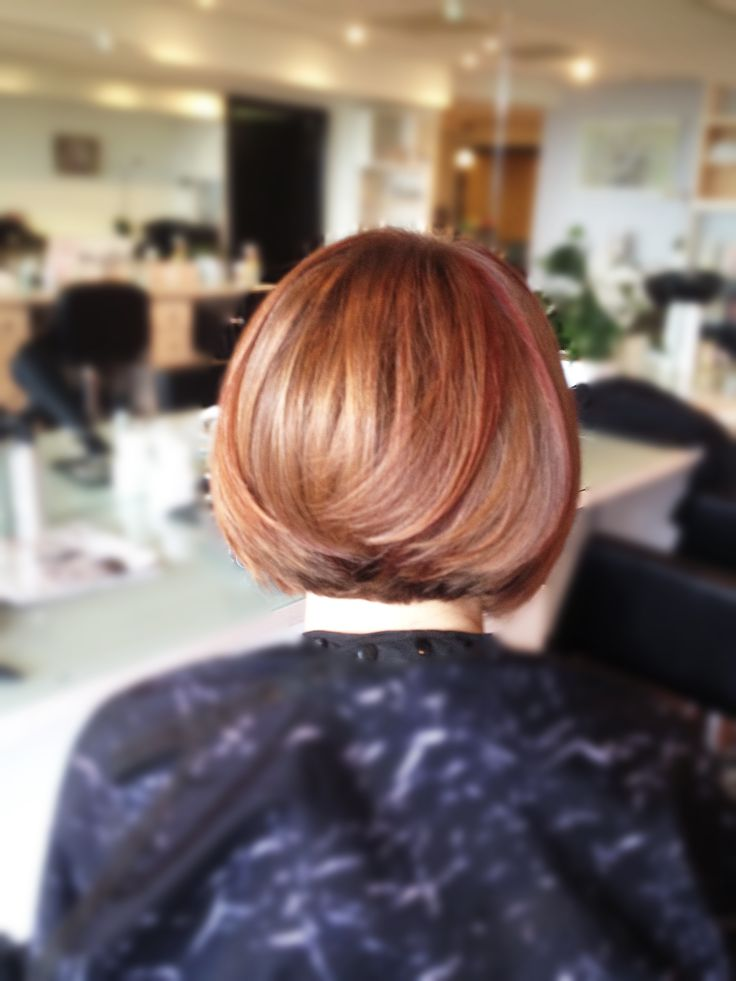 Short angled #A-line #haircut with side swipe bangs. Gorgeous #golden #blonde, #chocolate brown, #mahogany and #violet #red #haircolor.   From the #gorgeous A-line bob haircut to longer hairstyles, Salon Del Mar SB can customize the latest #trend #cuts for anyone.