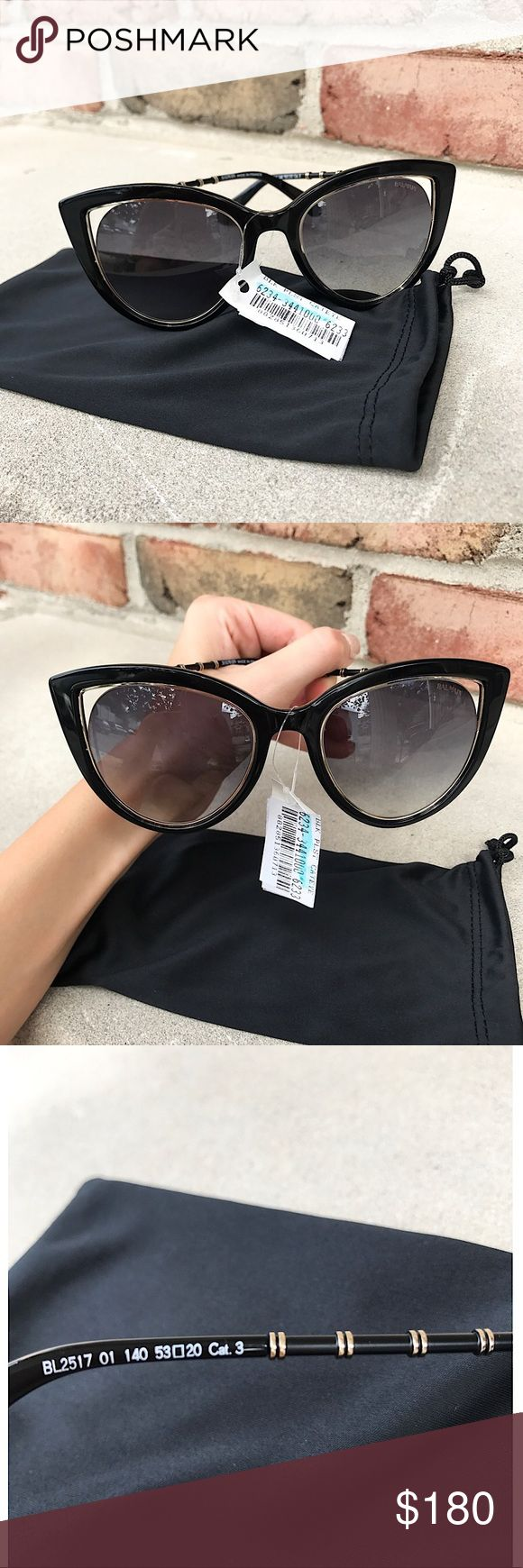 Balmain Sunglasses 😎 Glossy black rims, cat eye frames, cutout lenses, gold-tone trim, saddle nose bridge, integrated nose pads. Logo lettering at temples, tinted lenses, tonal metal arms with gold-tone ring detail, 100% UV protection 53mm lens width, 20mm bridge width, 120mm temple length Acetate/Metal Made in France BRAND NEW WITH TAG!!! Balmain Accessories Sunglasses