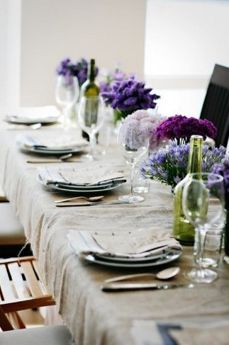 Beautiful linens, flowers and a table cloth always make an occasion more special! also can bring burlap runner down the center of white cloth and this table is now rustic and with any color of flower