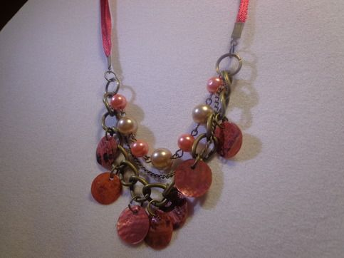 Beautiful combination of glass & shell beads in red ribbon chain  18 inches with additional chain for more length.