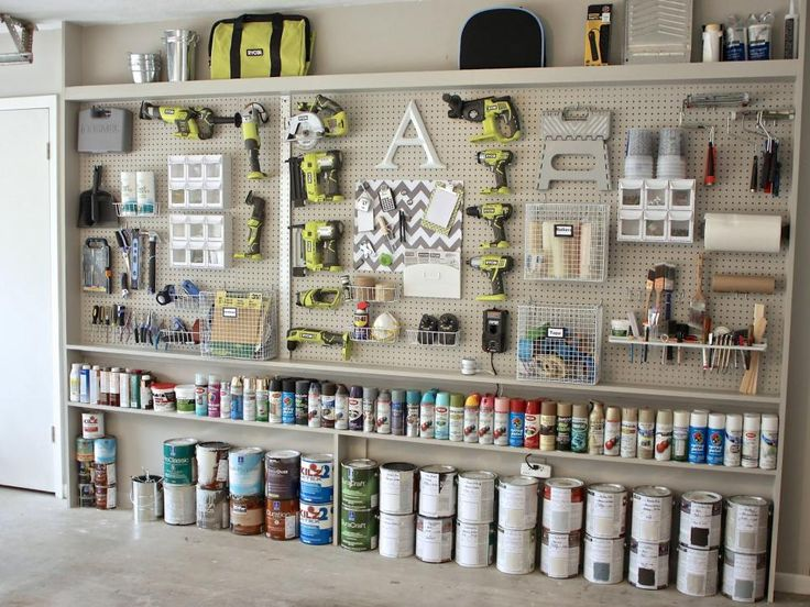A garage gets a massive functional upgrade with this pegboard and shelving installation by author and blogger Cyndy Aldred of The Creativity Exchange. A variety of hooks and baskets hold paint supplies and tools for effortless organization.