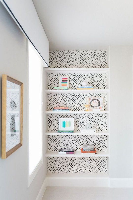 Wallpapered wall and floating shelves