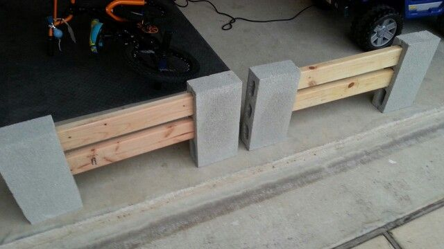 Cheap EZ DIY Mobile fence. Use light weight cinder blocks and a couple planks. Add paint if you wish. Great for garden borders, porch fencing, etc.