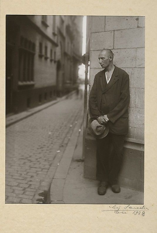 """Arbeitslos, 1928 August Sander (German, 1876–1964) This photograph is the final plate in """"Antlitz der Zeit"""" (""""Face of the Time""""), Sander's typological study of German citizens. A poignant image of disempowerment, the picture reveals Sander's prescient understanding of the social and economic forces at work in the Weimar Republic. Taking Sander's sympathetic portrayal of Germans of all occupations and ethnicities as a serious threat, the Fascists destroyed the printing blocks and most copies…"""
