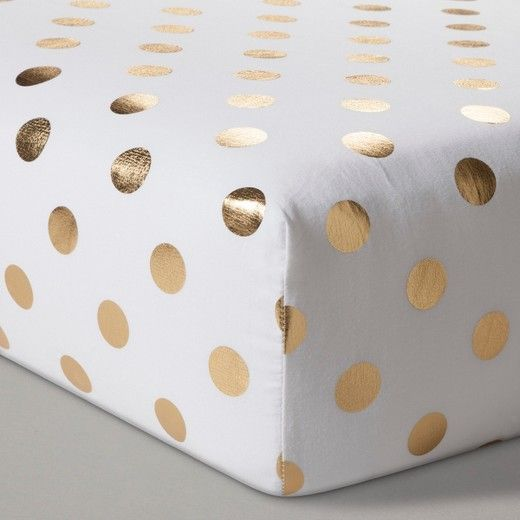 For the bright new addition in your life, fit their bed with the Gold Dot Fitted Crib Sheet from Cloud Island.