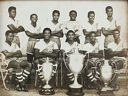 Black Stars (Ghana national football team) members in the 1960s pose with some of Ghana's successive international football trophies won