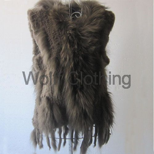 One size left in this beige to browns large (UK size:  12-14) raccoon and rabbit fur gilet.   Contact:  wolffboutiquefashion@gmail.com