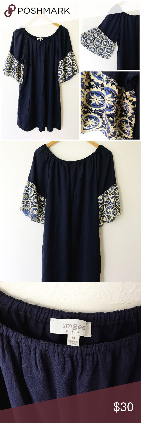 Umgee Navy Off Shoulder Lace Sleeves Shift Dress Excellent condition, beautiful Lace design at the hem of he sleeves, elastic top allows for an off the shoulder or open shoulder look. Loose, comfy and versatile. Wear it over a bathing suit or with some sandals and a cute tote for a day out. Umgee Dresses