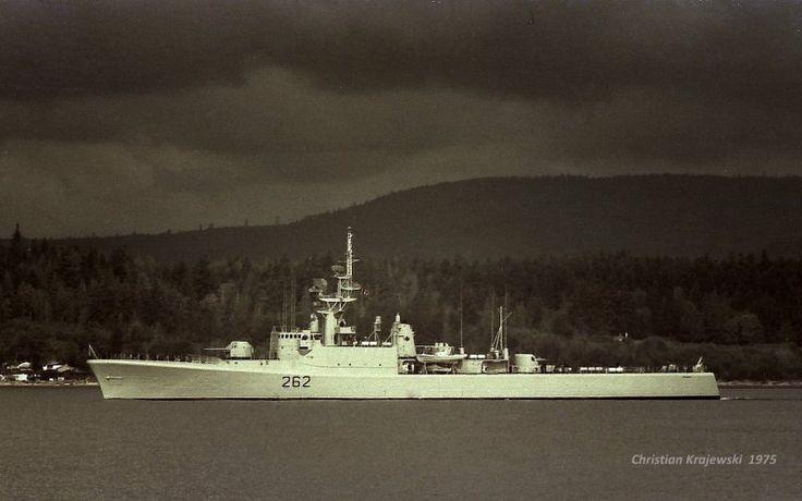 40 years ago, under very dark clouds, HMCS SASKATCHEWAN (1963-1994)steaming out off Esquimalt naval base. Photo taken from the YFP 308 in Auguste 1975.