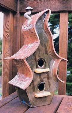 Ceramic bird houses based on a storybook