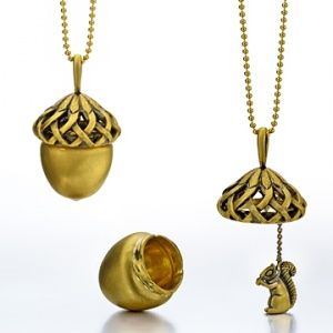 This is awesome! A necklace that has a squirrel hidden inside an acorn.