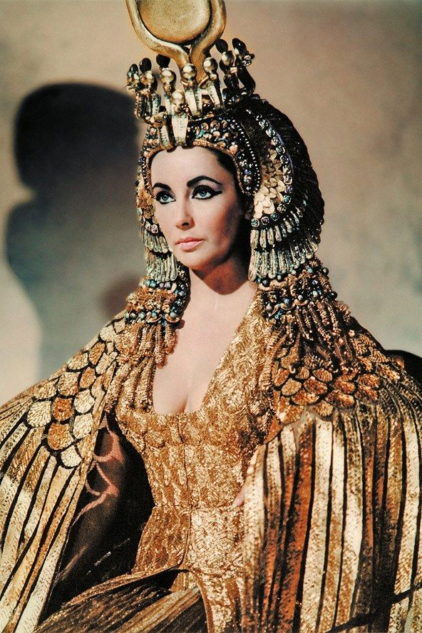 Elizabeth Taylor as Cleopatra in the eponymous film.  It was the highest grossing film of 1963 but the lavish production had taken 3 years and nearly bankrupted the studio.  Co-starring Richard Burton as Marc Anthony, the film marked the beginning of Burton and Taylor's famous and enduring / on / off love affair.