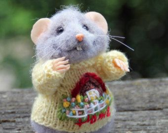 Mouse in fancy knitted sweater