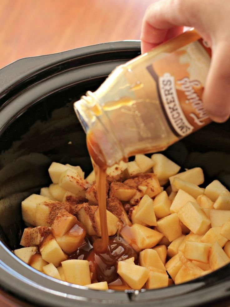 Slow Cooker Caramel Apple Pie Dip // i made this for a party a few weeks ago, but changed up the recipe. i used brayburn apples and old fashioned caramel dip, and put that in my 1 qt crockpot on warm. served it with stacy's cinnamon sugar pita chips. very easy and great!
