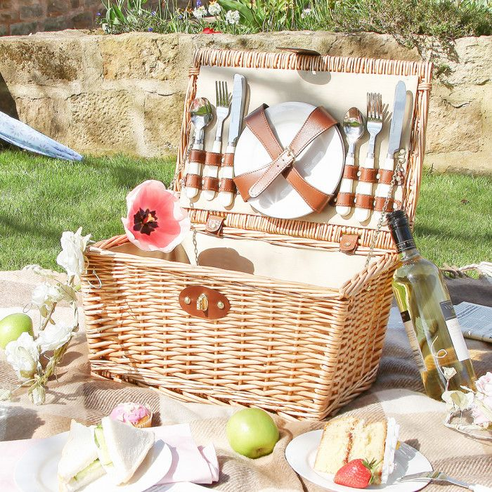 A simply beautiful picnic hamper to be enjoyed for years to come. Made from traditional peeled wicker with chocolate brown leather like straps and a handle to the top for easy transportation to the beach or the park. Internally brass chains hold the lid open whilst there is all you need for alfresco dining, the included place settings contain 4 ivory china plates and 4 sets of stainless steel cutlery so all you need to add are the sandwiches. A fantastic wedding or anniversary gift idea that…