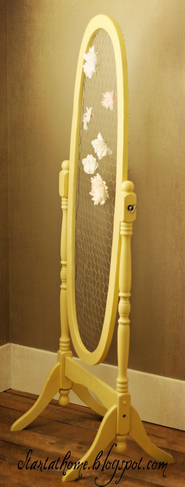 How about an old mirror frame with chicken wire...I want to make this for all of my earrings.
