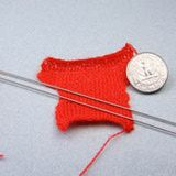 Miniature knitting for a dolls house doll on 5/0 1mm (size 19 UK) needles)