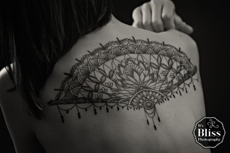 By Ryan from Tainted Skin, Crown Point, IN. Victorian lace fan with cactus flower inside.