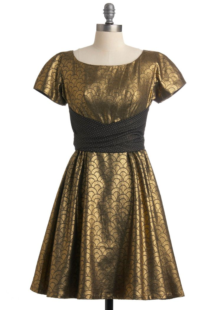 You'll want to slip into this elegant, glimmering frock by Lowie any chance you get! Started in 2002 by designer Bronwyn Lowenthal, Lowie aims for ethical production and stunning design. Small production runs ensure limited-edition pieces, while Lowie uses hand-makers and small manufacturers to make their unique goods, including this golden, scallop-textured frock. A fit-and-flare silhouette is enhanced by the attached sash belt and full skirt. Go for a whirl with this dress and dramatic…