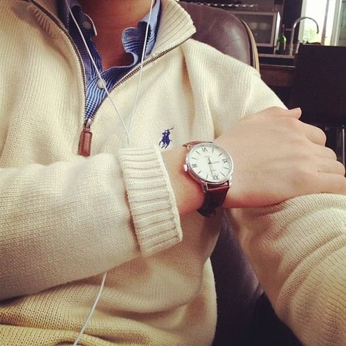 POLO Ralph Lauren quarter-zip sweater, Daniel Wellington leather strap watch, and gingham button-up.