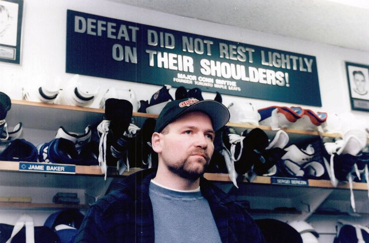 Wendel Clark in front of Conn Smythe's famous motto that adorned Maple Leaf gardens for many years. The sign would be particularly significant during their Cup runs in '92/'93. Clark was the face of the era and looks as if he is dealing with a tough loss.