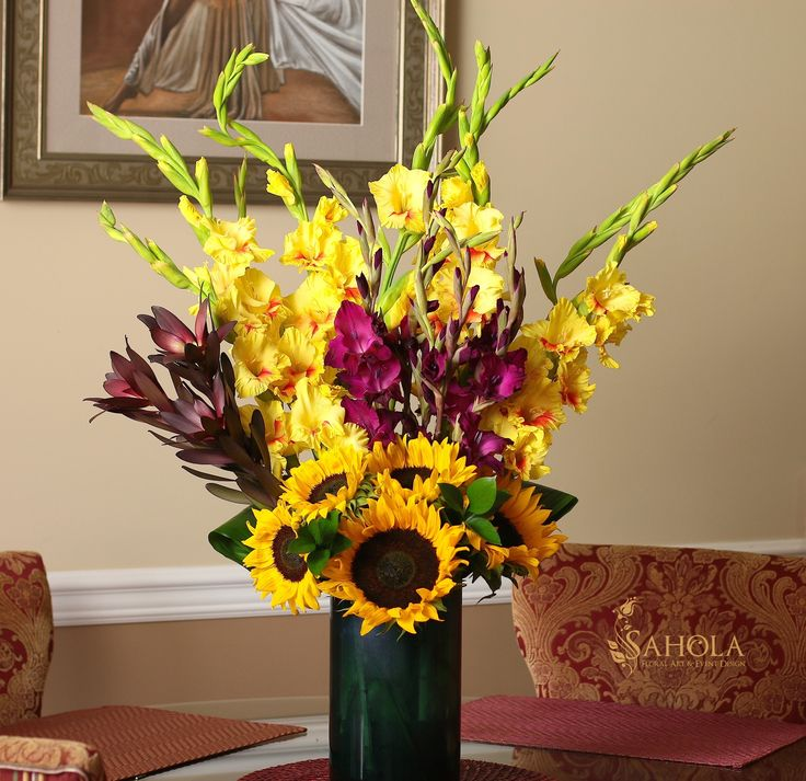 Bright summer flower arrangement with sunflowers and gladiolus. Bouquet made by New York Floral Designer SAHOLA  This and other unique flower arrangements available at www.saholany.com #saholaflowers  #bouquet #flowerstagram #floraldesigner #newyorkflorist