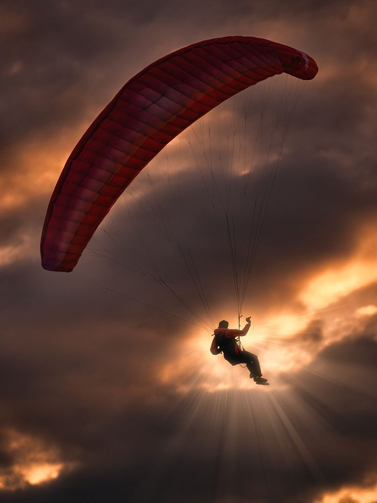 maya47000: The paraglider against the sun by Georg Haaser