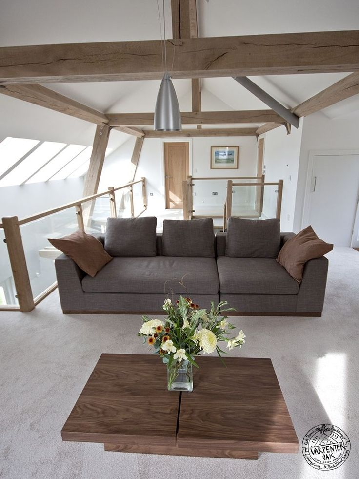 Traditional timber framing combined with modern steel fixings to create light and airy open spaces by Carpenter Oak