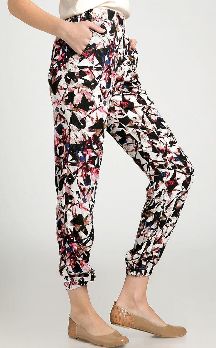 Hatsy Pants by Zavica. Long pants that made from good material with abstract triangle prints, with a combination of black, white, blue, purple, magenta color and it also has side pockets. Pair this pants with plain top and flat shoes for casual style. http://www.zocko.com/z/JIl40