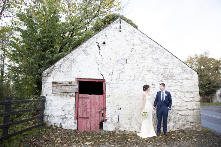 Bride and groom outside old Irish house. Copyright: http://juliecummins.com/
