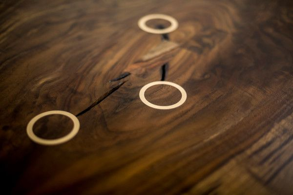 Metal rings in wooden table - Handcrafted Furniture by Jeff Martin Joinery