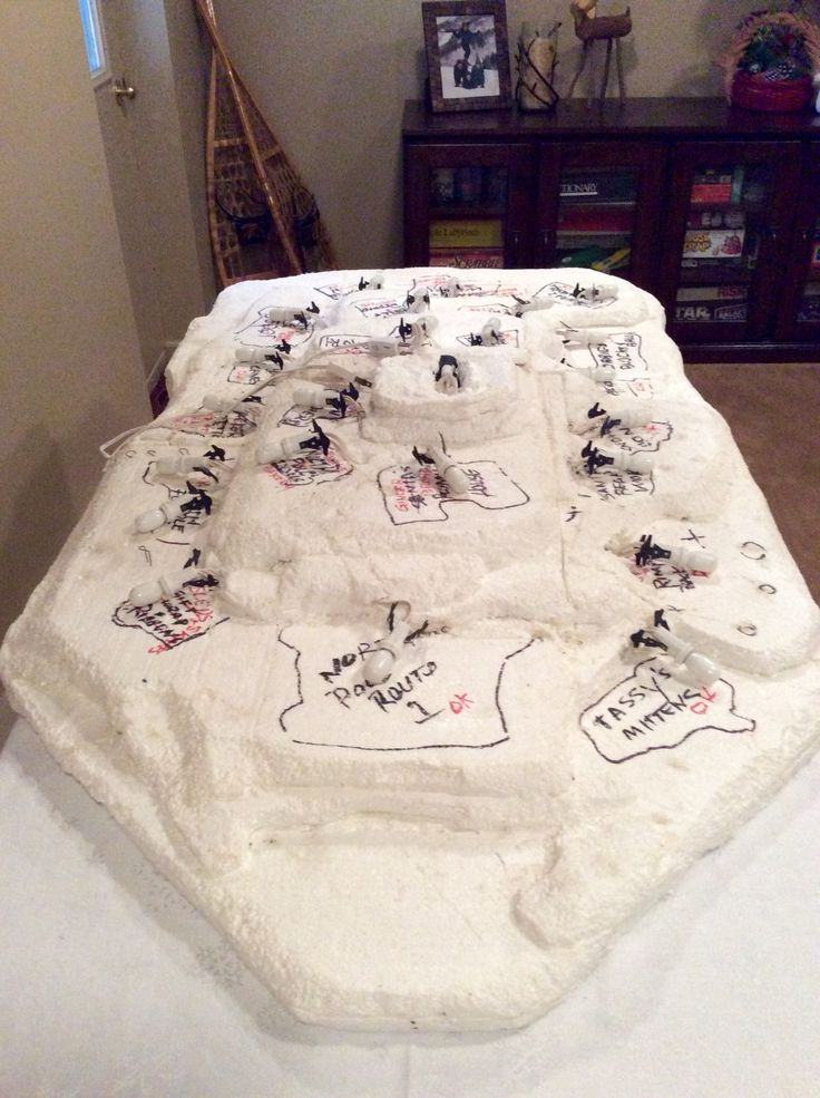 """This is brilliant!  - """"Set up a white Christmas display board for a Department 56 village. My father custom made this for my North Pole village - you can see all set up on this board in other pictures. It's made of harder type of styrofoam that he layered and sculpted, then coated and sealed with a sort of glue. All the lights and wiring are incorporated so that only one plug needs plugged in. Two switches turn on like 24 houses. I set it up on a collapsible banquet table. Stores in my…"""