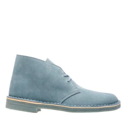 Updated in a blue grey suede, the original Desert Boot from Clarks stays stylish and versatile. Launched in 1950 by Nathan Clark, the Desert Boot was inspired by a rough boot from Cairo's Old Bazaar. An instant hit, it became the footwear of choice for off-duty army officers. Often imitated, never bettered, it's clean lines are teamed with a simple lace fastening and a signature crepe sole.