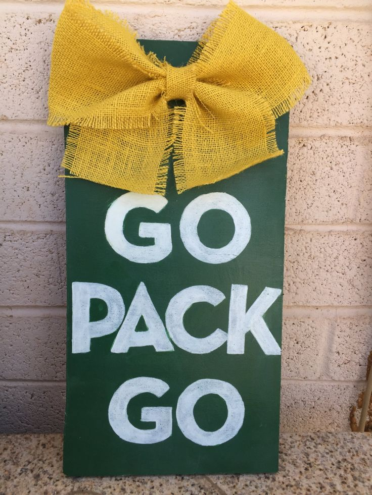 NFL Green Bay Packers distressed wooden sign with yellow burlap bow 16x8 (All teams available) by binniesboutique on Etsy