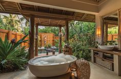 Wonderful tropical outdoor bathroom with a marvelous white soaking bathtub. 10 Astonishing Tropical Bathroom Ideas That You Must See Today ➤To see more Luxury Bathroom ideas visit us at www.luxurybathrooms.eu #luxurybathrooms #homedecorideas #bathroomideas @BathroomsLuxury