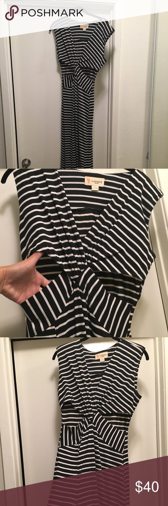 Cut out dress Striped cut out dress with high slit.  Great dress for going out! Only worn once, no flaws at all. Has cut outs one each side as pictured and a high slit up the right leg L'atiste Dresses Maxi