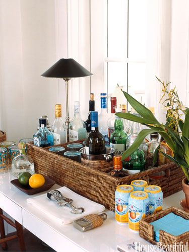 Organized bar. Design: Tom Scheerer. housebeautiful.com #home_bar #basket #beach_house