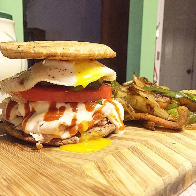 Tonight's early dinner/snack is a turkey/egg/Queso sandwich! Broiled 2 Joseph's mini pitas and then stuffed them with boars head turkey breast, queso, avocado, sriracha, tomato, sautéed peppers/onions and a runny fried egg  these sandwiches are so good and are ultra low carb for you guys low on carbs   Macros for sandwich: 278 cals, 20g carbs, 11g fat, 30g protein, 8g fiber  FlexibleDietingLifestyle.com  #flexibledietinglifestyle #ifitfitsyourlifestyle