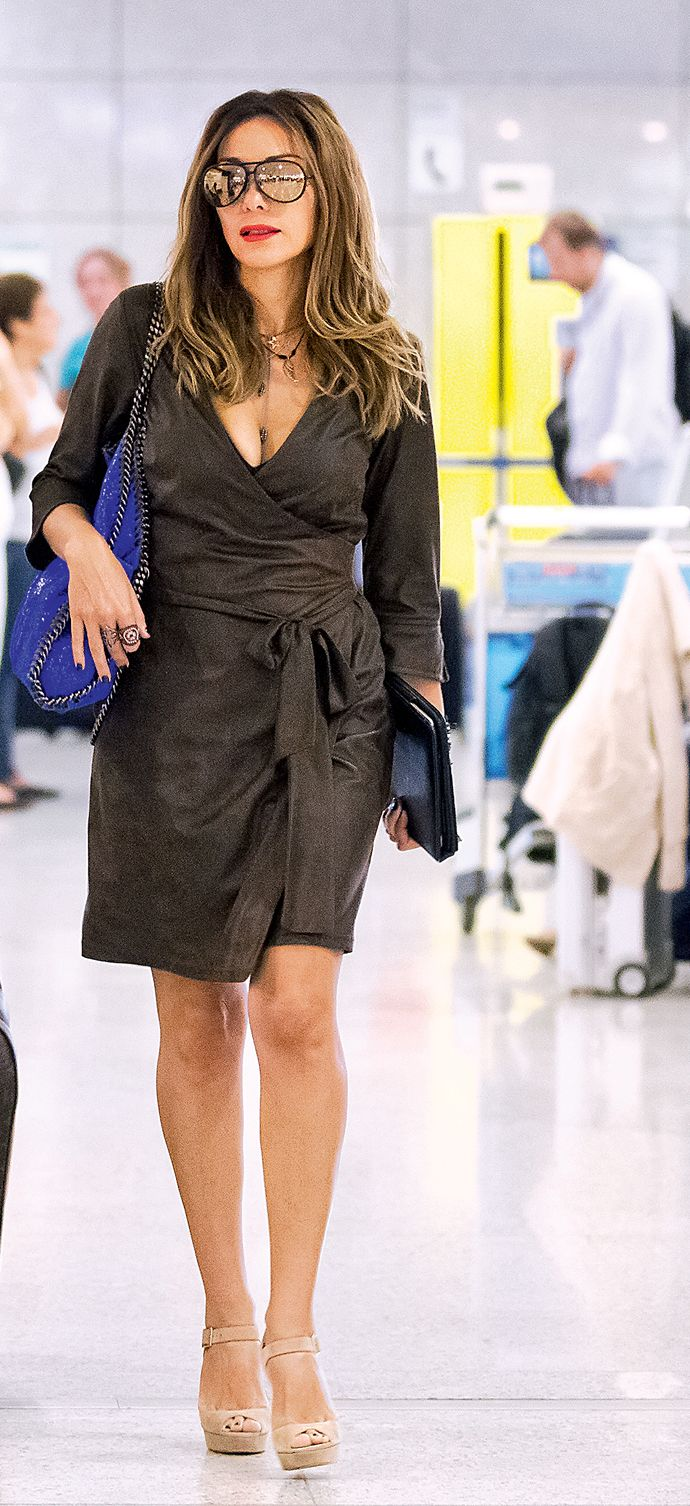 """Despina Vandi wearing the wrap dress from the f/w collection """"Despina Vandi for Chip&Chip""""."""