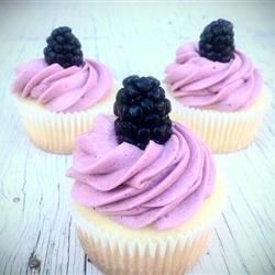 A simple from-scratch lemon cupcake has blackberry buttercream frosting. This cupcake is a refreshing hit! Garnish each cupcake with a blackberry or a pinch of lemon zest.