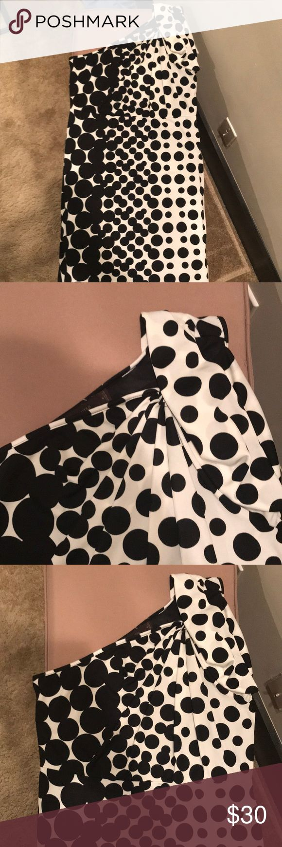 The limited black and white one shoulder dress