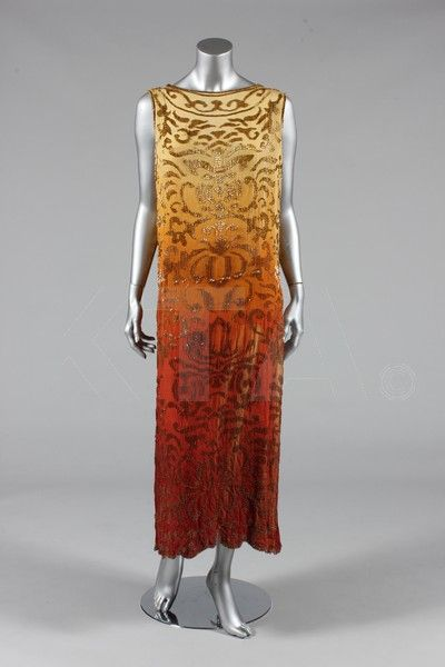 Evening dress, ca 1922 - Bust is 117cm/42in, about a size 20 UK/16 US or (in plus sizing), 18 UK/14W US.  Click to go to the absentee bidding page. This Kerry Taylor auction will end October 16th at 2:00 PM GMT (9:00 AM EST). You will need to register to bid ahead of time.