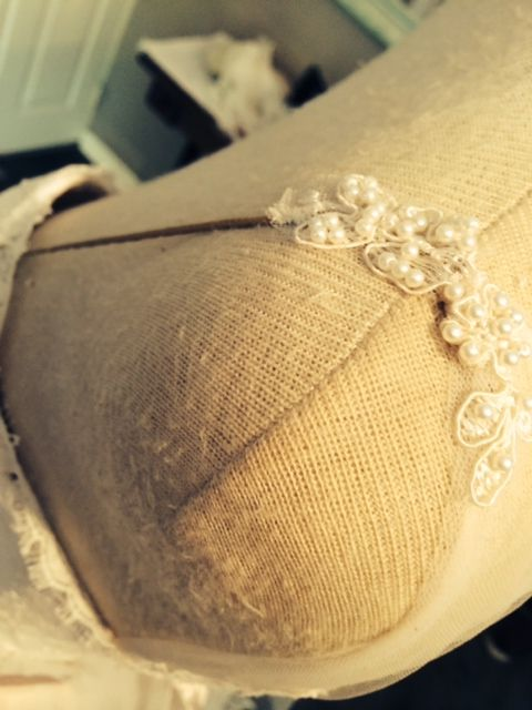 Pearly lace and leather strap detail.