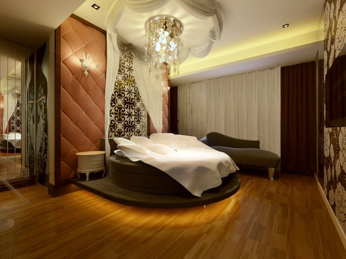 Elegant master bedroom in multiple wood tones, white, hard wood floor, large brown bed with tray ceiling