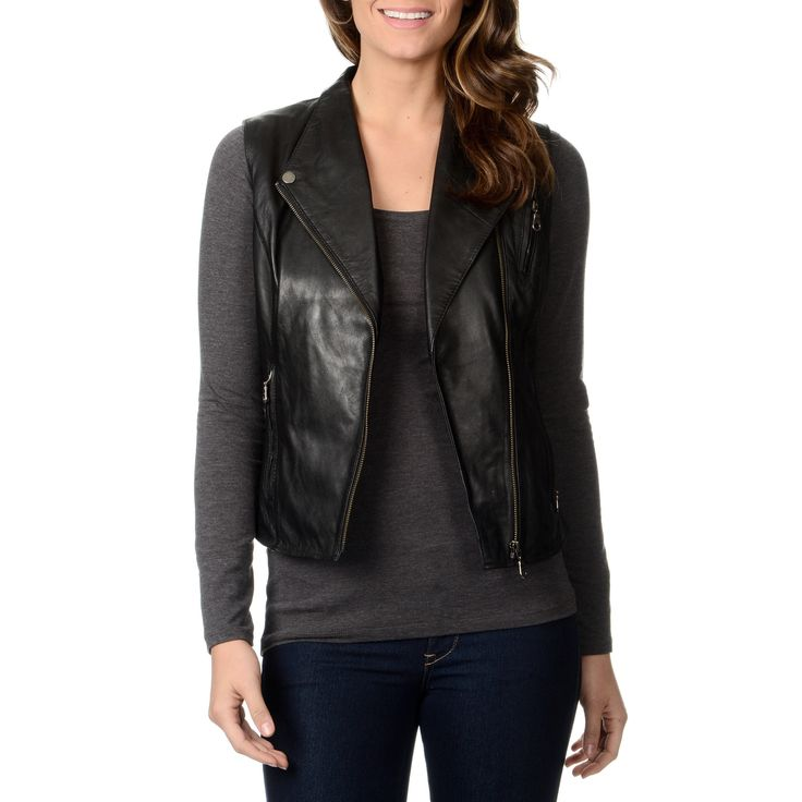This women's motorcycle leather vest from Whet Blu features an asymmetrical zip front closure complemented by a spread collar with snaps. Two zipper pockets and one zipper chest pockets pulls this look together.